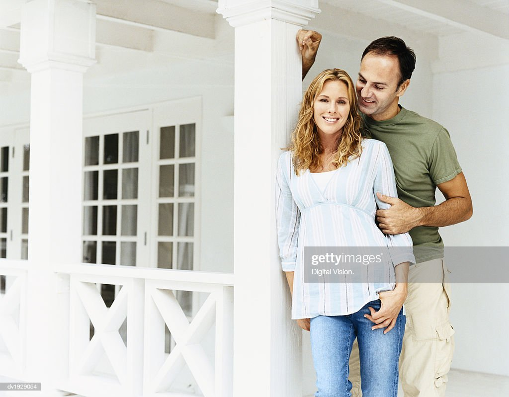 Portrait of a Couple Standing Together on Their Porch : Stock Photo