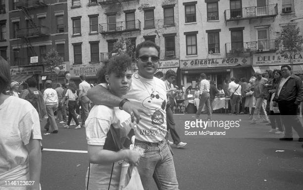 Portrait of a couple the man's arm around the women as they walk on 9th Avenue in Hell's Kitchen during the International Food Festival New York New...
