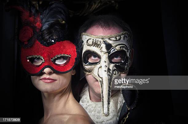 portrait of a couple wearing venetian masks - masquerade mask stock photos and pictures