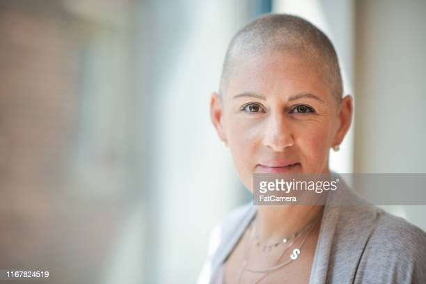 portrait of a courageous woman with cancer - survival stock pictures, royalty-free photos & images