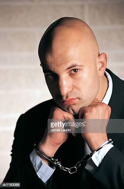 Portrait of a Criminal Businessman Wearing Handcuffs