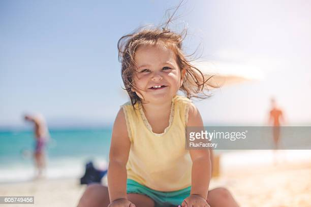portrait of a cute baby girl on the beach