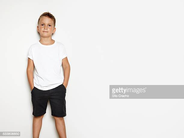 portrait of a cute boy wearing white t-shirt - white shirt stock pictures, royalty-free photos & images