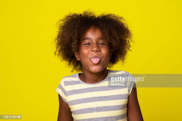 portrait of a cute girl sticking tongue out - protruding stock pictures, royalty-free photos & images