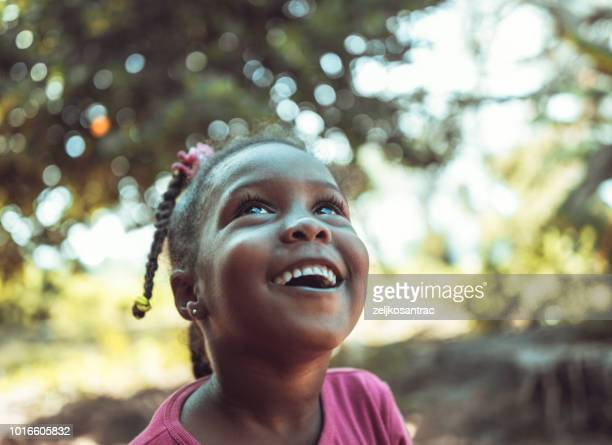 portrait of a cute little african girl - looking up stock pictures, royalty-free photos & images