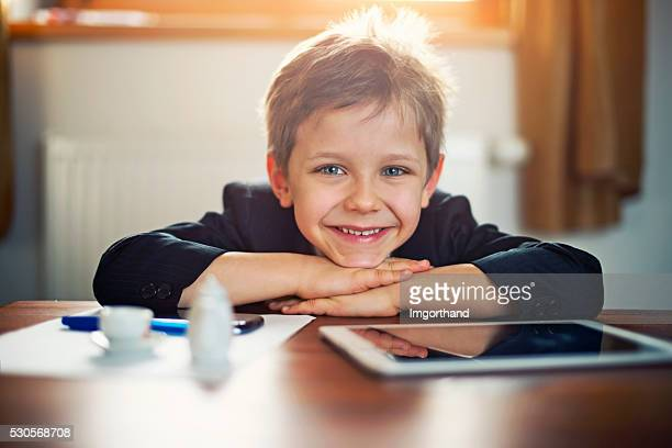 Portrait of a cute little boy playing business man