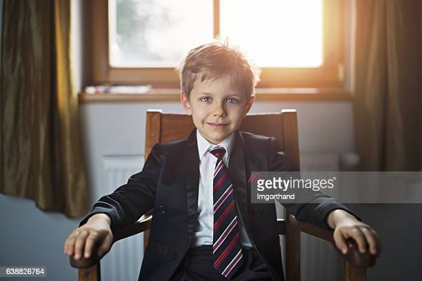 portrait of a cute little business man or politician - president stockfoto's en -beelden