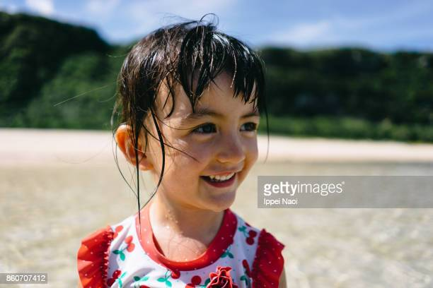 portrait of a cute mixed race toddler girl on beach, japan - 鹿児島県 ストックフォトと画像