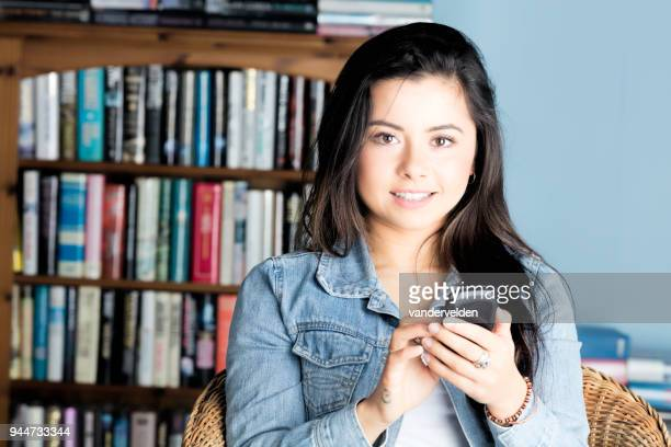 Portrait of a cute, mixed-race lady texting