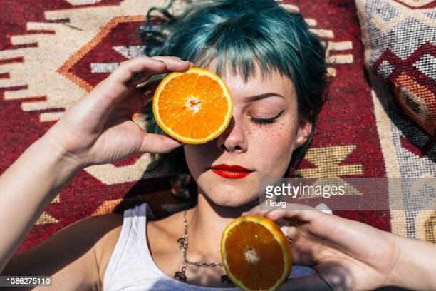 Portrait of a cute woman with oranges