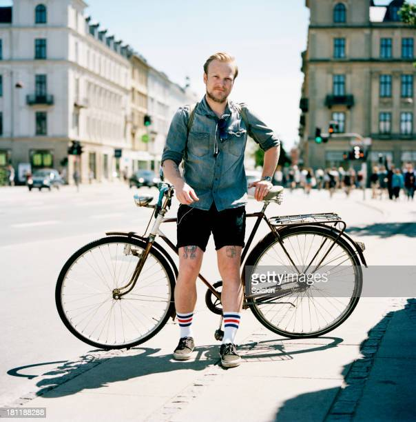 Portrait of a cyclist standing in city surrounding