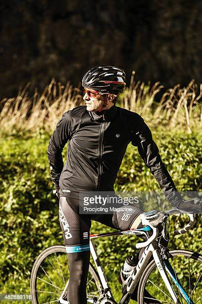 Portrait of a cyclist with a Cube Litening Super HPC SL road bike photographed Cheddar Gorge in Somerset, taken on November 4, 2013.