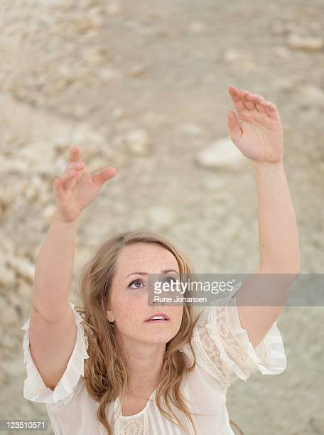 portrait of a danish woman, 28 years old, looking up with arms streched up - 25 29 years stock pictures, royalty-free photos & images