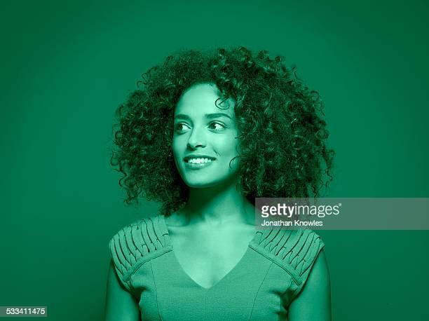 Portrait of a dark skinned female,looking away