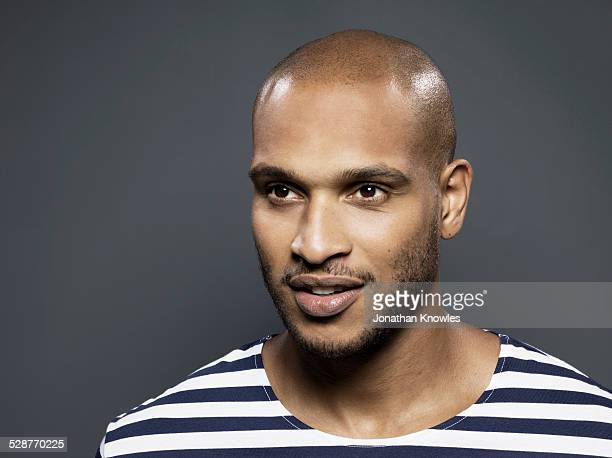 portrait of a dark skinned male - shaved head stock pictures, royalty-free photos & images