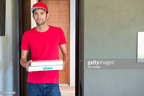 Portrait of a deliveryman delivering pizza