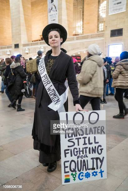 Portrait of a demonstrator dressed as a suffragette who holds up a sign during the Non-March For Disabled Women inside Grand Central Station, New...