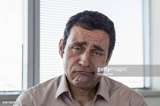 Portrait of a depressed businessman in office