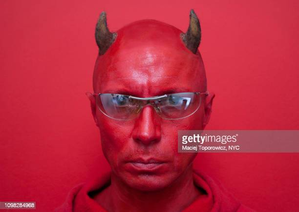 portrait of a devil in sunglasses. - devil stock pictures, royalty-free photos & images