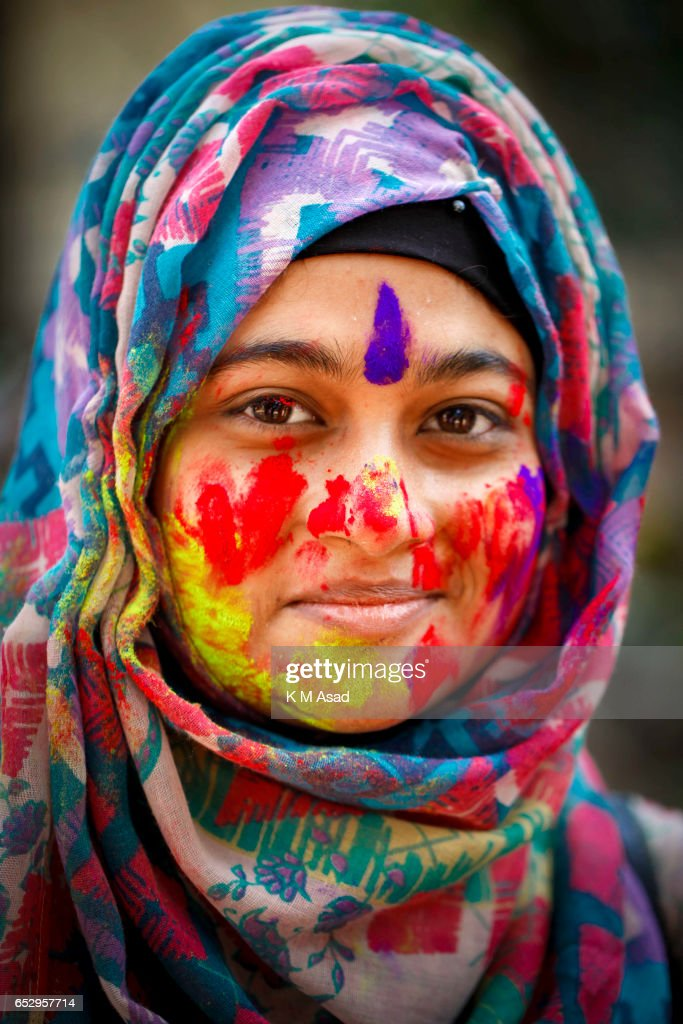 UNIVERCITY, DHAKA, BANGLADESH - : Portrait of a Dhaka University fine Art Student celebrate the Holi Festival or Festival of Colors after smearing each other with colored powder in Dhaka, Bangladesh. Holi festival is celebrated on the full moon day in the month of Phalguna and marks the start of the spring season.
