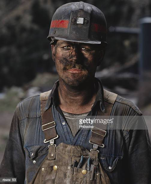 portrait of a dirty caucasian male coal miner - coal miner stock photos and pictures