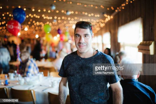 portrait of a disabled man at a party - disabilitycollection stock-fotos und bilder