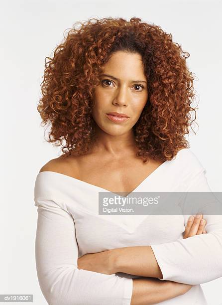 Portrait of a Displeased Woman, with Long Curly Hair and Her Arms Crossed