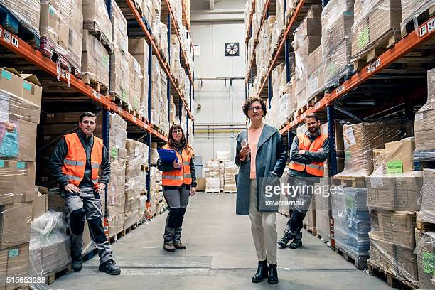 portrait of a distribution warehouse team - satisfaction stock pictures, royalty-free photos & images