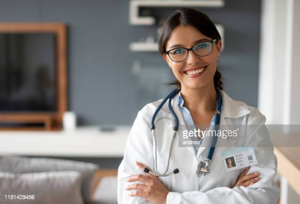portrait of a doctor making a house visit - house call stock pictures, royalty-free photos & images