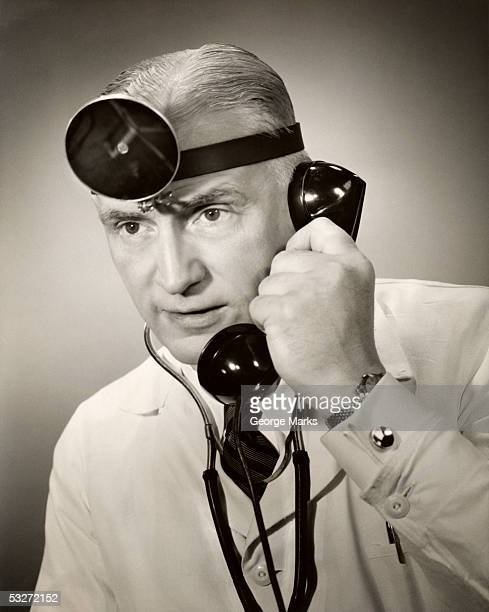 portrait of a doctor on the telephone - 20th century stock pictures, royalty-free photos & images