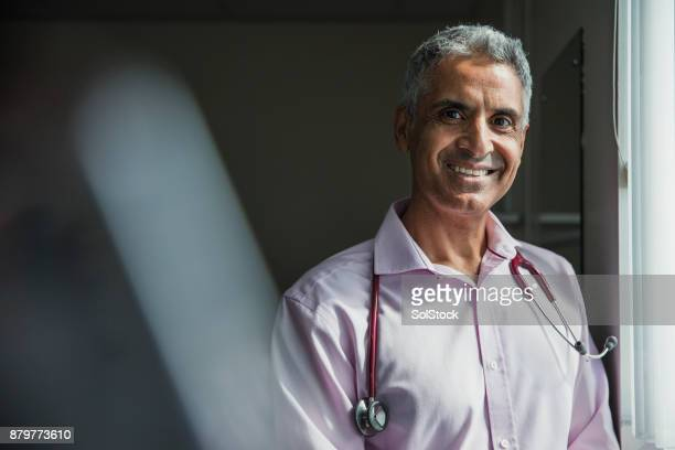 portrait of a doctor - males stock pictures, royalty-free photos & images
