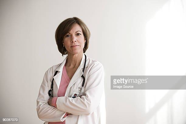 portrait of a doctor - female doctor stock photos and pictures