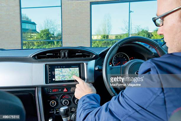 Portrait of a driver with a Pioneer head unit fitted in a Subaru BRZ photographed for a feature on Apple's CarPlay taken on December 19 2014