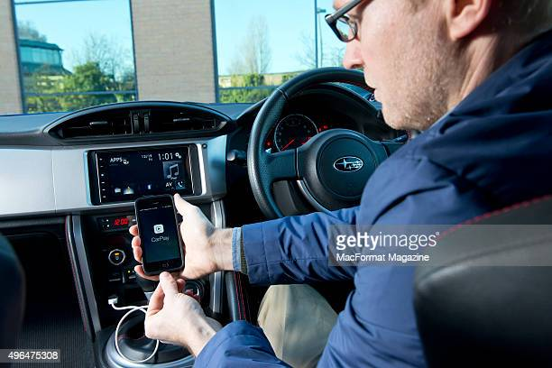 Portrait of a driver with an Apple iPhone 5 and Pioneer head unit fitted in a Subaru BRZ photographed for a feature on Apple's CarPlay taken on...