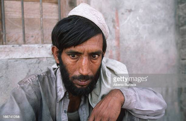 Portrait of a drug addict after having taken his daily heroin dose Heroin is cheaply sold in the city's black market as it is cheaply produced in the...
