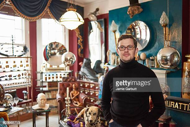 a portrait of a early 30's antique dealer - eccentric stock pictures, royalty-free photos & images