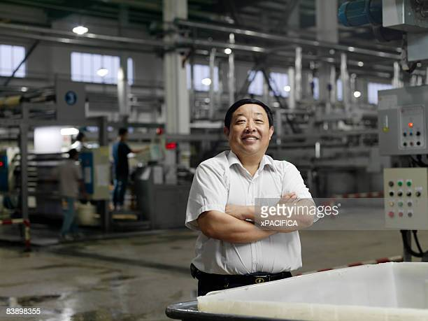 A portrait of a engineer of a textile factory.