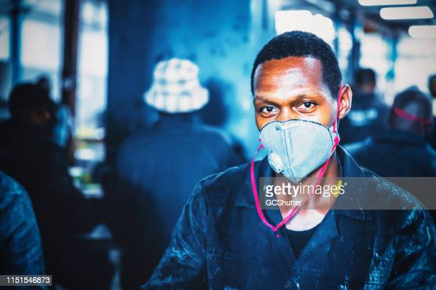 portrait of a factory worker wearing protective mask - may day stock pictures, royalty-free photos & images
