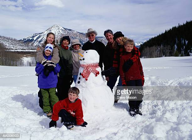 Portrait of a Family by a Snowman