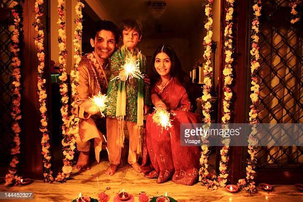 Portrait of a family celebrating Diwali