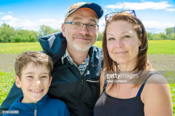 Portrait of a family in a park during summer day