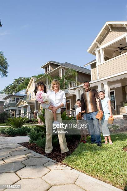 Portrait of a family in front of their house