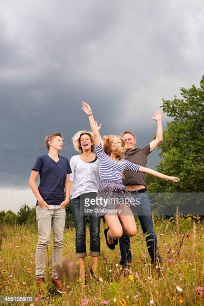 Portrait of a family jumping on a flower meadow on August 12 in Duelmen Germany Photo by Ute Grabowsky/Photothek via Getty Images