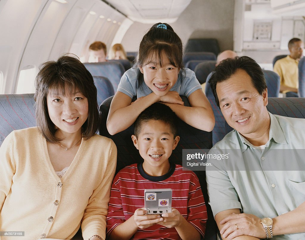 Portrait of a Family of Four on a Plane : Stock Photo
