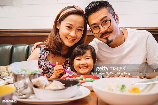 Portrait of a family sitting at dining table