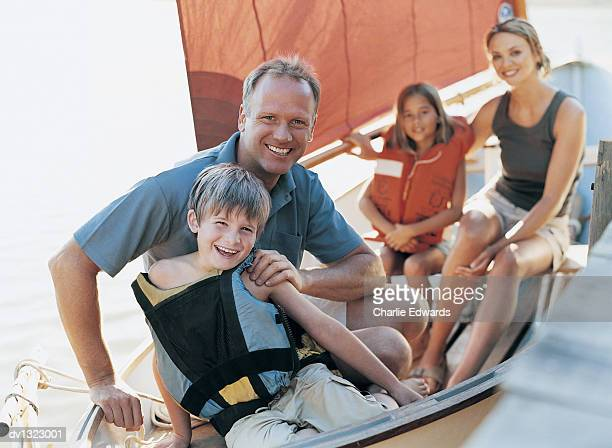 Portrait of a Family Sitting in a Sailing Boat