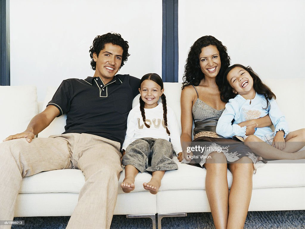 Portrait of a Family Sitting Together on a Sofa : Stock Photo