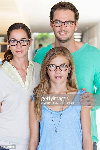 Portrait of a family wearing eyeglasses and smiling