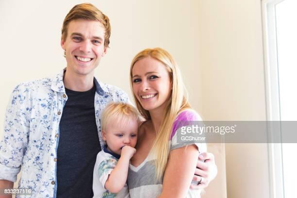 1 つの子を持つ家族の肖像画