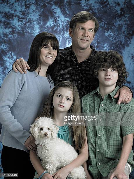 portrait of a family with poodle - daughter photos stock photos and pictures